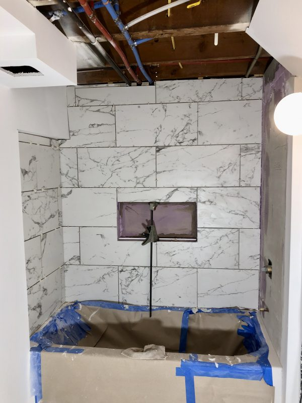 12x24 faux marble tile in bathtub surround: Sima Spaces Spring 2020 ORC